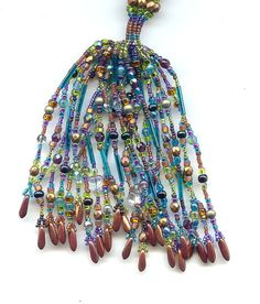 https://www.etsy.com/listing/94894933/caged-ndebele-lariat-kit?ref=shop_home_active_11