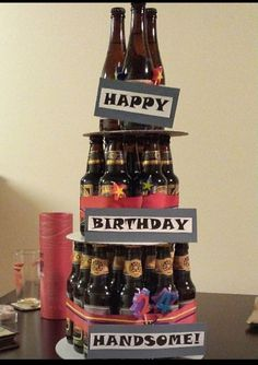 Beer Bottle cake I made Nathan. It took 3 for the top, 7 for the middle, and 14 for the bottom. 24 pack works perfect, so mix and match. Make sure to get the same height beer for each level or it doesn't work well.