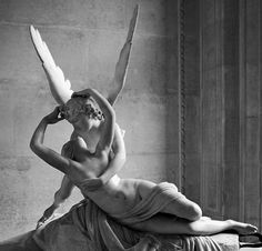 first saw this awesome sculpture in Louvre by Antonio Canova (1794), titled: Psyche Revived by Cupid's Kiss.