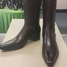 NEW SANTONI LADIES SIZE 37 TALL BROWN BOOTS New Santoni pointed toe high brown leather boots. Retail for approx $900. They are listed as a size 37 which converts to a 7 for US. They look like they are for skinny feet. Each boot has a dust cover and I have the box but it's a little banged up. There is a small scuff area on the top of one boot. I have a pic included. Almost looks like someone was trying to pull them up and scuffed the leather.  Reasonable offers will be considered. santoni…