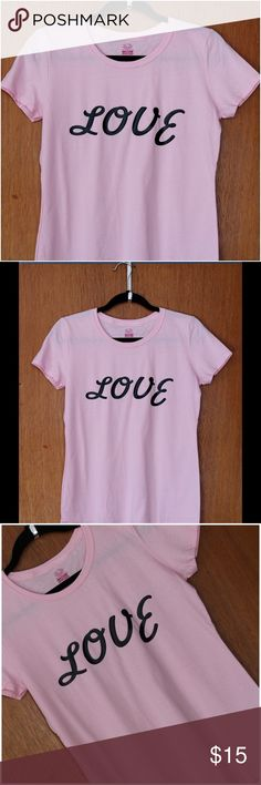 Love T'shirt Classic Pink 💕 Love T'shirt   Color: Classic Pink  Features: * 100% cotton preshrunk jersey * Seamed 1x1 rib collar * Double-needle coverstitched front neck * Double-needle stitched bottom hem and sleeves * Contoured and sideseamed for a feminine fit * Athletic Heather is 90% cotton, 10% polyester  We use High Quality Heat Press Vinyl  Care:  * Wash inside out * Tumble dry low * Do not dry clean. * Machine wash COLD / mild detergent. Tops Tees - Short Sleeve