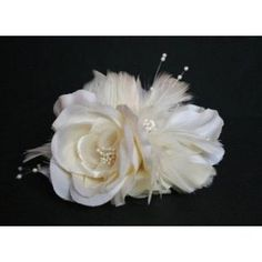 Beautiful and Elegant. Soft Ivory bridal hair flower is handmade with various ivory shades of silk flower petals. Pearls embellish the flower centers and edges. Ivory goose feathers are nestled among the flower petals and add wonderful texture. Feather Flower sits on a silver double prong hair clip.    This beautiful product is made exclusively for Elegant Bridal Shop with the highest quality.