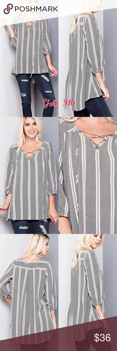 Casual pullover tops This gorgeous pullover top has a lace up vneck front and front print. 100% polyester - Price is firm. S(2/4) M(6/8) L(10/12) Boutique Tops