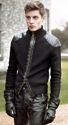 Leather trousers with leather trim knitwear. Would be easy to steampunk this outfit.