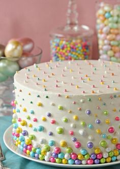 Easter Polka Dot Cake: Stunning beyond measure, this polka dot cake will delight your family even more when they discover the mini colorful cake balls hidden inside. Click through to discover more easy decorating ideas for the best Easter cakes. Cake Decorating Piping, Cake Decorating Designs, Birthday Cake Decorating, Cake Birthday, Decorating Ideas, Easy Kids Birthday Cakes, Easy Cake Designs, Simple Cake Decorating, Simple Birthday Cake Designs