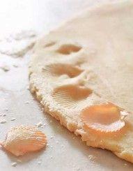 Decorate a pie crust using a seashell!
