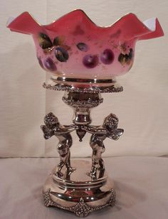 Cased Glass Dimpled Bride's Bowl With Ruffled Rim Decorated With Hand Painted Enamel Cherries And Gilded Edge, Silver Plate Frame With Cherubs By Toronto Silver Plate    c.1900