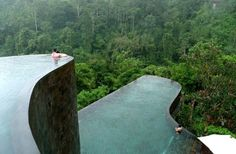 The Ubud Hanging Gardens in Bali boasts two levels of a spectacular infinity pool, suspended over a densely forested valley, with separate buildings dotted along the forest like treehouses.
