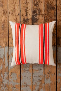 Handwoven envelope style pillowcase with bold stripes and a wooden button closure on the back.   - Measures 24