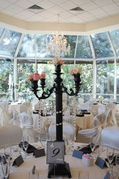 Black Candelabra Centerpiece (needs more flowers. Black Candelabra, Candelabra Centerpiece, Centerpieces, Table Decorations, Marrying My Best Friend, Marry Me, Happily Ever After, Purple Flowers, Floral Design