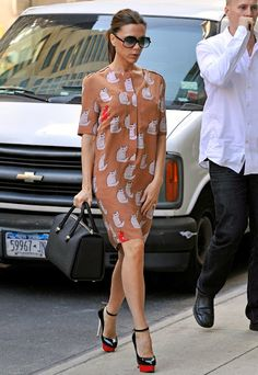 Victoria Beckham designed this kitty print dress she's wearing