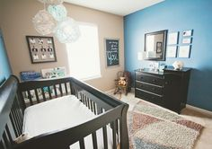 I love the color scheme and the 9-picture frame on the wall. It would be fun to put up sonogram pictures