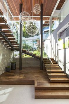 1232 Sunset Plaza, West Hollywood, CA, by Belzberg Architects - grand stair with glass windows, glass guardrail, open risers, modern, wood, sculptural pendant lighting, natural lighting, view
