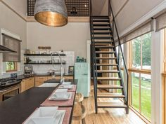 To create extra living space, the Gaines added a loft, which is accessed by a ship ladder staircase. (Photos: Airbnb/Shotgun House)  via @AOL_Lifestyle Read more: https://www.aol.com/article/finance/2017/06/30/a-one-bedroom-home-that-was-purchased-for-28-000-on-fixer-uppe/23010685/?a_dgi=aolshare_pinterest#fullscreen