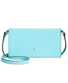 Cleverly designed with dedicated slots for your phone, cards and Id, this kate spade new york crossbody is the modern girl's go-to for day, play and even a dinner date. | Saffiano leather | Imported |