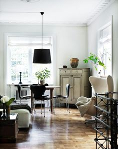 This might be a bit too conservative for me, but I like the way dark items balance the lightness of the room. It's not romantic, but it is truly sofisticated.  And of course, a hint of green is always good :)