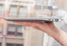 The Ativ Book 9 Plus is extremely similar to the older Book 9: gunmetal-blue on the outside, silver edges, a curved, tapered profile like an airfoil, and a footprint smaller than a 13-inch MacBook Air.