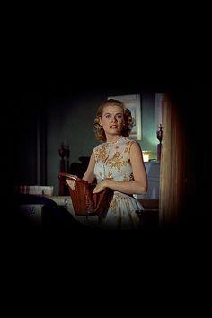 "Grace Kelly sneaking into the villain's apartment in ""Rear Window"""