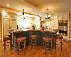 Curved kitchen island strictly reference for multiple heights at