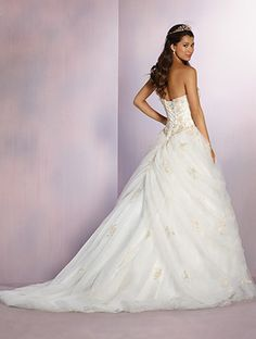 A princess wedding gown with embroidery, strapless neckline, dropped waist, and ball gown skirt.