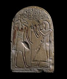 Limestone stela decorated with sunken relief representation of Aaphty and Seth; Hieroglyphic text.