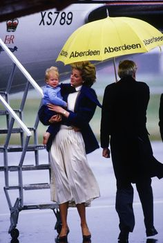 September 23, 1985: Princess Diana holding Prince Harry at Aberdeen preparing to board the Queen's flight for Heathrow.