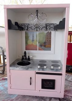 Repurpose an ugly entertainment center into a showstopping French kitchen that any child would love (I think cutting out the back to make a real window would be another idea)