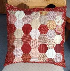 Hand pieced quilted hexagon cushion cover