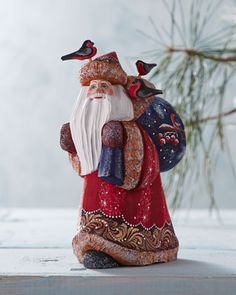 G. DEBREKHT Happy Traveler Santa What sets G. Debrekht creations apart from the norm is the unexpected, highly detailed scene found on each one. Brightly colored traveling Santa figurine is hand painted to add unique charm to the holidays.