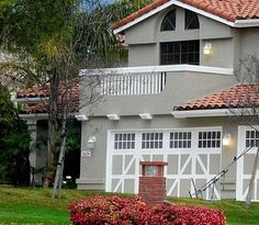 Image result for beautiful house with gray color wall and red roof