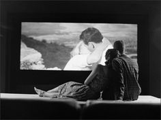 A young couple at a drive in theater, 1961