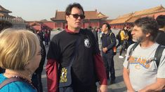 Leading a group through the Forbidden City in Beijing, China