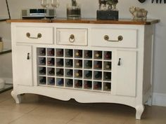 If you don't mind a little elbow grease, create your own wine buffet for the dining room from a bedroom dresser (or similar furniture piece). Look for furniture with good bones, then knock out drawers, add wine cubbies and a fresh coat of paint. Kim and Lori of That's So Creative are the masterminds behind this repurposed wine buffet.