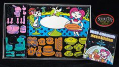 Colorforms  (this is Miss Cookie's Moon Kitchen from 1969 -- I had another version of this from the 1970's that I can't find any images of on the internet)