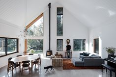 A cosmopolitan and contemporary barn house amongst tall majestic trees, hoop trees and pillar rock in the rural areas of Byron Bay is the epitome and quintessence behind what a family home appears to be for Tim Sharpe and his wife. Interior Architecture, Interior And Exterior, Interior Design, Commercial Architecture, Contemporary Barn, Living Spaces, Living Room, Australian Homes, Concrete Floors