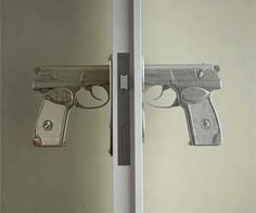 Hand gun style doorknobs. Pulling the trigger actually opens the door! Cool!