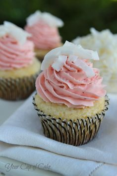 Strawberry Piña Colada Cupcakes...coconut cupcake batter uses white cake mix, coconut extract and milk, pineapple filling and strawberry buttercream frosting