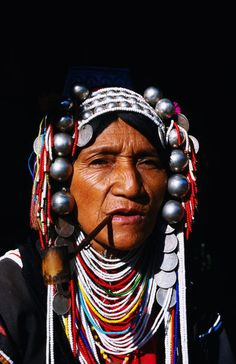 Akha woman smoking pipe in northern Thailand.