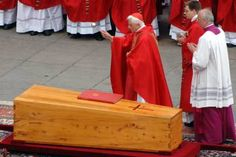 German Cardinal Joseph Ratzinger blesses the coffin of Pope John Paul II during his funeral in Saint Peter's Square, April 8, 2005.