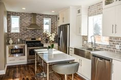 Transitional Kitchen with High ceiling, Hardwood floors, Atlanta Wall Thin Brick Veneer, Glass panel, Custom hood, L-shaped