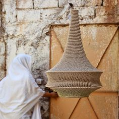 On the road to the Atlas Mountains at the far reach of Marrakesh city rests a little village where a community of women handcraft our crochet pendant Pendant Light Fitting, Pendant Lights, Hanging Lamp Shade, Cotton Textile, White Lead, Light Fittings, Hand Crochet, Decoration, A Table