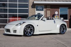This 2005 Nissan 350 Z Convertible has a Liter 287 H. 5 Speed Automatic Transmission w/ Manual Gate Shift, Traction Control System, limited Slip. Nissan 350z Custom, Nissan 350z Roadster, Nissan Z Cars, Nissan 370z, Jdm Cars, Honda S2000, Honda Civic, Nissan 350z Convertible, Mitsubishi Lancer Evolution