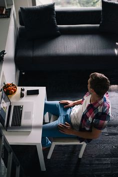 Young Designer Working on Laptop at his Home Office by marija   Stocksy United
