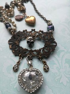 Memento mori, Victorian gothic, assemblage necklace, skull necklace, unique ooak artist jewelry, rosary upcycled reworked, reinvented, Found Object Jewelry, Metal Skull, Skull Necklace, Vintage Heart, Memento Mori, Victorian Gothic, Heart Charm, Repurposed, Neck Deep