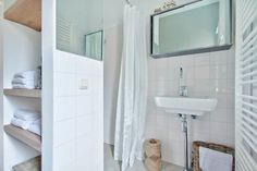 Your bathroom with shower and basin.