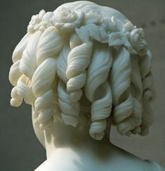 Beautiful flowers and curls on the Roma Lyman marble sculpture by William H. Rinehart. In the collection of Corcoran Gallery, Washington, DC. (Photo from socialhistoryofart.com)