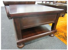 BURNISHED BROWN LIFT TOP COCKTAIL TABLE
