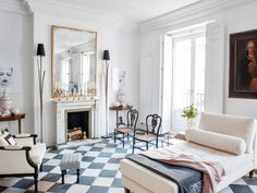 A Chic Spanish Apartment with Vintage Touches and Modern Updates Spanish Apartment, Lovely Apartments, Checkered Floors, Design Salon, Black And White Tiles, Black White, Elegant Dining Room, Living Spaces, Living Room