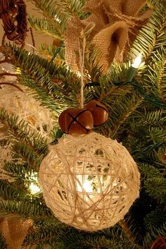 Blow up a balloon, wrap it with string, lace...paint, let dry, and pop the balloon...voila ornament! I'll try the lace. So pretty