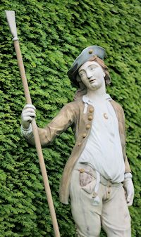 A painted statue of a shepherd, mounted on a stone pedestal on the lawn facing the rear of Fenton House, Hampstead, cast in lead by John Cheere in 1735 Fenton House, Hidden London, Brandywine Valley, Sunken Garden, North London, National Trust, Detached House, 17th Century, Pedestal